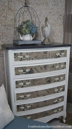 Top painted with Annie Sloan Chalk Paint in Graphite. Body painted with DIY Chalk Paint. Lightly sanded. Finished with AS Clear Wax. Fabric was mod podged to the front of each drawer. Original hardware was painted in  Rustoleum Almond Satin, then distressed with sandpaper.
