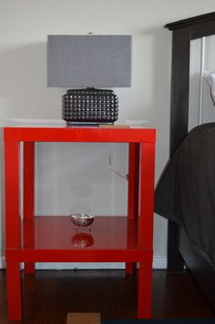 Materials: Lack Side Table – high gloss red Description: The budget for this project was very minimal, so we had to be very creative with our purchases. We purchased two Lack side tables in the high gloss red finish. Based on the drawings I did, the client selected option 1. The client cut all the [&hellip