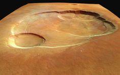 Vista del planeta Marte desde Europa                 Monte Olimpo de Marte  El Monte Olimpo, el mayor volcán conocido en nuestro Sistema Solar. Este gigante se eleva hasta los 22 kilómetros de altura sobre la superficie de Marte