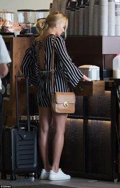 Down time: Margot, who picked up a beverage before boarding her flight, had been spending some quality time with her family in the Gold Coast