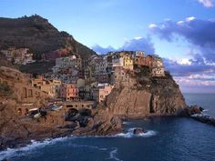 A very small town, Manarola is located in the province of La Spezia, Liguria, northern Italy and can trace its origins back to the 14th Century. Description from marquetteturner.com. I searched for this on bing.com/images
