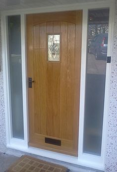 Wooden front doors with side panels google search extension exterior pinterest for Exterior doors with side panels