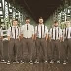 pretty much what we're aiming for, groom in vest and groomsmen in suspenders