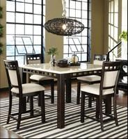 The Gateway dining set is part of Standard's Modern Fusion collection. It features square legs, extra thick marble veneer tops and an open ladder motif on apron rails and chair backs. It comes in both counter height and regular height versions with a choice of wood framed chairs and fully upholstered, oversized parson's chairs. Featured in the May 20, 2013, Issue of Furniture Today.