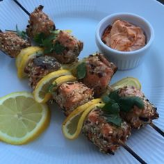 Try these low carb spicy salmon kebabs with yogurt and harissa dip 😍 #Leanin15    Crushed chilli  Cumin  Oregano Sesame seeds Salmon  Olive oil  Greek yogurt  Harissa paste