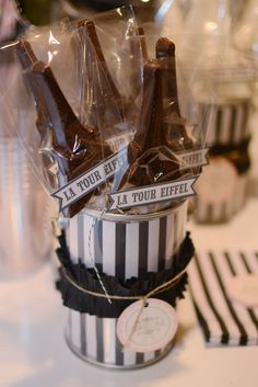 buy paris eifel tower molds or cookie cutters and fill with chocolate and put in freezer