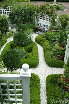 Sculpted hedges give structure to the kitchen garden. Standard bay, roses, hops, and espaliered apple trees in Charlotte Moss' East Hampton garden. Path Design, Landscape Design, Formal Gardens, Outdoor Gardens, Garden Paths, Garden Landscaping, Moss Garden, Herb Garden, Garden Hedges