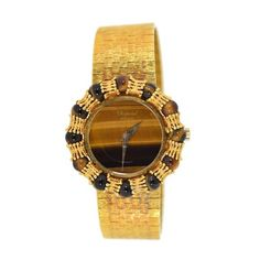 Pre-owned Chopard Tigers Eye 18K Yellow Gold Manual Vintage 31mm... (69.495 BRL) ❤ liked on Polyvore featuring jewelry, watches, 18k gold watches, gold jewellery, 18 karat gold watches, 18k gold jewelry and vintage wristwatches