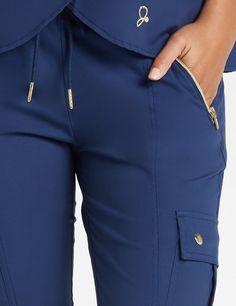 Modern Scrubs and Lab Coats for Men and Women by Jaanuu Stylish Scrubs, Scrubs Uniform, Medical Uniforms, Nursing Clothes, Medical Scrubs, Scrub Pants, Radiology, Caregiver, Jogger Pants