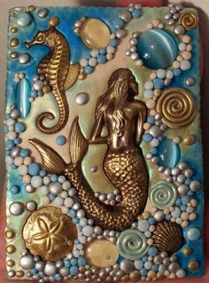 Ivory clay, pigment powders, mermaid. Love the clay bubbles along the change in color on the background