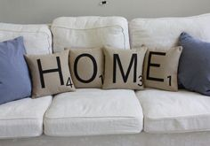 Librarian Tells All: Shopping List: Housewarming Gifts  - Would pillows make a new place cozier? Scrabble Throw Pillow Covers by dirtsastudio on etsy