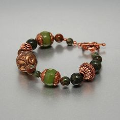 HERBS - Green and Copper Bracelet with artisan beads   Design by PALMYRA - Treasures from Orient and Occident