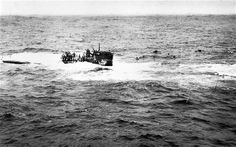 1944 photo provided by the U.S. Navy, shows crewmen of German submarine U-550 abandoning ship in the Atlantic Ocean after being depth charged by the USS Joyce, a destroyer in an Allied convoy that the U-Boat attacked.