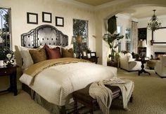 Large ornately designed master bedroom with separate living room.