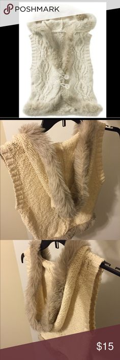 Old navy fur classic hoodie cable-knit swtr vest Fur trim adds standout style to a classic hoodie cable-knit sweater vest. Features a button-loop front, rib-knit arm holes and rounded hem. Body 96% cotton, 4% other fiber, imitation fur. Old Navy Sweaters