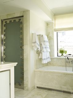 Phoebe Howard Polished Nickel Door // Stone // Undermount Tub // Millwork; Where did Phoebe find someone to do that door?