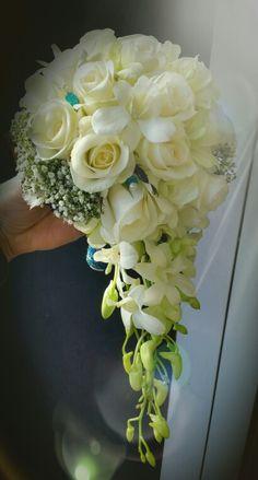 Bruidsboeket met orchideeën, gipskruid  en rozen