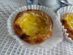 Portuguese Custard Tarts These classic pastries are everyone's favorite. Once you experience just how easy they are to make at home, you'll never buy them at a bakery again. Unless of course, your lucky enough to be. Portuguese Custard Tart Recipe, Portuguese Tarts, Portuguese Recipes, Portuguese Food, Tart Recipes, Dessert Recipes, Cooking Recipes, Desserts, Holiday Recipes
