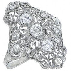 This is a charming diamond platinum ring from the Art Deco era. The ring is set with sparkling old mine cut diamonds that weigh approximately 1.20ct.