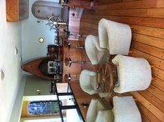 Nautical bar..love the ship wheel table.