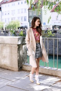 Fashion blogger Veronika Lipar of Brunette From Wall Street sharing how how to wear mini skirt on a cold spring day