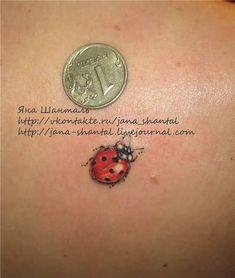 Amazing Coin And Ladybug Tattoo On Back