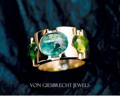 This original, hand-made ring is made in 18kt yellow gold.   Notice the unusual setting of the blue & green cabochon tourmalines. This is a variation of the traditional 'closed' setting; here I have left the sides cut open to allow more light into the stones. Cabochon gemstones often have inclusions in them, which can be appreciated for their natural beauty.  The French refer to these inclusions as 'jardins'.      Also available in white gold or silver with coloured gemstones of your choice.
