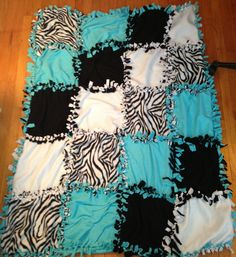 No Sew Tie Fleece Quilt Blanket- 20 squares 1ft 3in each. Cut 4 3in squares out of each corner in the squares and then cut 3 in fringe. Tie together. Get a big piece of fabric for the back and tie the big piece to the squared piece. Super cozy and warm. - Original design by Shannon Kearns -