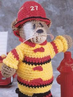 "Fireman Bear - Fire up hours of playtime for firefighters of all ages.  Size: 12"" tall (appx)  Designed by Lori Jean Karluk  free pdf from FreePatterns.com"