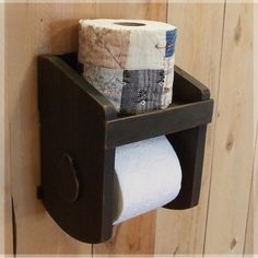 Primitive Toilet Paper Holder for the Bathroom / Original Design / Farmhouse Favorite / Quilt Wrapped Spare Roll. $35.00, via Etsy.