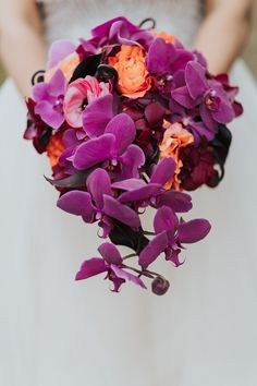 Bright, bold colorful wedding bouquet inspiration. Bridal bouquet with purple dendrobium orchids, pink ranuculus, orange-peach roses. Vivid orchid wedding bouquet for winter wedding. Unique wedding bouquet. Bridal bouquet. Wedding flowers. Floral Inspiration. Floral design. wedding bouquet ideas. Beautiful wedding flowers. Wedding color inspiration. Wild wedding flowers. Wild wedding bouquet. Cascading wedding bouquets. unstructured wedding bouquets. Organic wedding bouquet Orchid Bouquet Wedding, Cascading Wedding Bouquets, Wedding Flowers, Purple Orchid Bouquet, Bridal Bouquets, Jewel Tone Wedding, Purple Wedding, Wedding Colors, Wedding Unique
