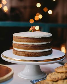 This naked cake practically screams fall, with pumpkin layers doused in maple syrup and spread with