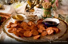 Easy, tasty reception appetizers -- grilled sausage cut into rounds and served on a nice tray with a variety of mustards.  For variety, you could include a variety of specialty sausages as well.