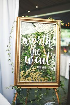 """Yes to calligraphy on a gold framed mirror! What a pretty detail...""""Worth the wait"""" gold mirror wedding sign // A Tropical Wonderland: Kim and Bernice's Colourful Vintage-Inspired Wedding {Facebook and Instagram: The Wedding Scoop}"""