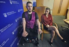 Retired Marine Sergeant John Peck speaks about his double arm transplant with his fiancée, Jessica P... - AP Photo