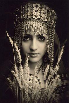 Turkmen girl in tribal silver headdress.