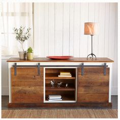Build a sliding barn door console using my step by step free plans. This is a knock off of the Yorkville Sliding Door Console from Sundance Catalog. Furniture Projects, Home Projects, Diy Furniture, Sliding Barn Door Hardware, Sliding Doors, Sliding Table, Barn Door Console, Console Table, Barn Door Cabinet