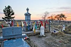 The Wounded Knee Monument and graves at sunset
