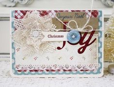 by Melissa Phillips: Lilybean Paperie PTI:  Wonderful Words - Joy and Global Greetings:  Christmas' Wonderful Words - Joy die; Christmas Poinsettia dies once again and used them with cream burlap and vintage trim.