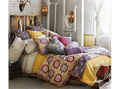 Bohemian bedroom... Love the bed frame