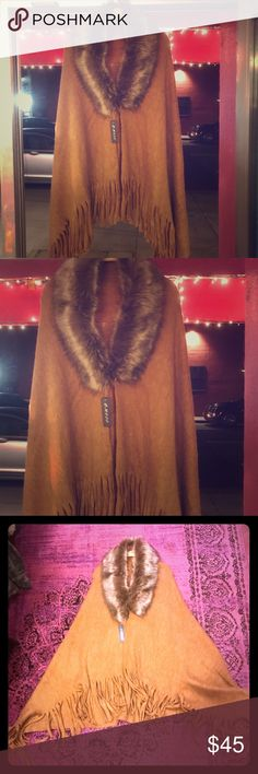 Casual long PANCHO Fringe trim, faux fur neckline Casual long earthy mustard yellow PANCHO. Loose fit, fringe trim on asymmetric hem, open front with clasp, faux fur neck. This great PANCHO is 💯 percent Poly and it's MADE IN THE USA 🇺🇸 Accessories Scarves & Wraps