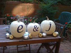 #DIY #engagementparty Silver, white and gold painted pumpkins with Navy stencil.