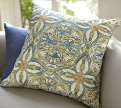 Porto Pillow Cover | Pottery Barn, I like how this pillow also has a little light green and light blue to keep it bright and fresh, but still ties in the navy.