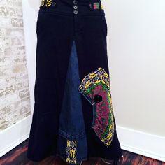 Long black maxi skirt designed with a unique boho denim style.