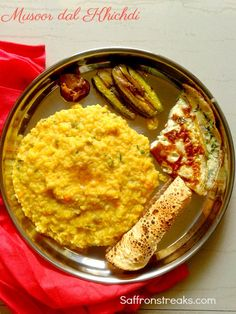 Bengali masoor dal khichdi recipe for monsoon days. Red lentils or masoor dal is cooked with par boiled rice and warm aromatic spices
