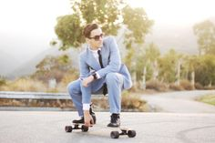 Longboarding man in a suit. whooopp. Every man should do this.
