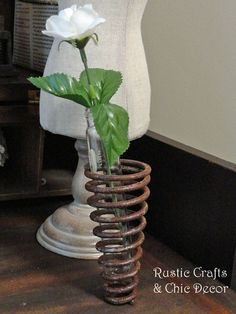 This rustic industrial bud vase is made from an old spring from a salvaged metal scrapyard. Simple, rustic and chic!
