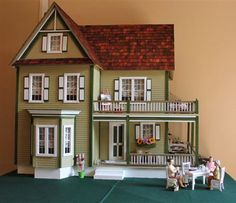 Victoria's Farmhouse I could build this dollhouse for you in the color of your choice. www.dollhousemansions.com