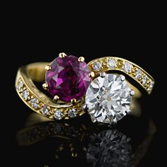 """A lovely, classic Victorian twin-stone ring featuring a high-quality, old Siamese ruby of a deep, vibrant magenta-red color, paired with a dazzling white European cut diamond. Both stones measure approximately 1.15 carats each. The """"18 ct"""" (hence, of British origin) and platinum setting was apparently (expertly) remade sometime back to replace the worn-out 100 plus year old original."""