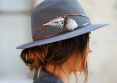 leather strap + feather on hat
